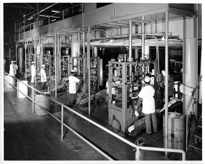 Male Workers Operating Machinery Inside the San Jose Mayfair Packing Co.
